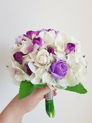Handmade artificial flowers bouquet made with silk and purple and ivory flowers
