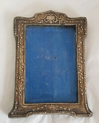 An Edwardian photograph frame.Sterling silver mount. Chester 1909