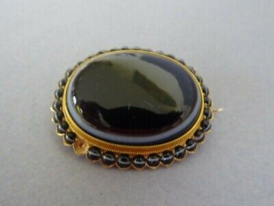 Antique Victorian gold bulls eye agate mourning brooch
