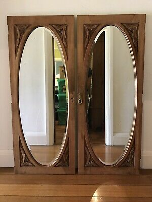 Pair of Antique Maple Framed Oval Mirrors