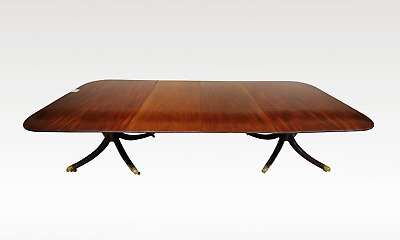 A Mahogany Twin Pillar Dining Table With Two Extra Leafs