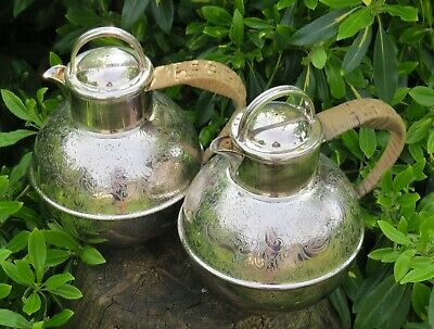 Pair Of Large 2 Pint Silver Plated Jersey Jugs With A Wicker Wrap Around Handles