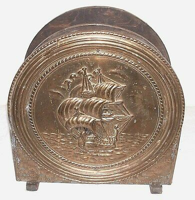 different style antique english brass magazine rack in fairly good condition