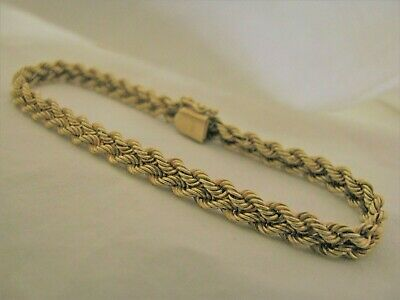 "13 Grams 7 1/2"" long 14k solid yellow gold braided bracelet"