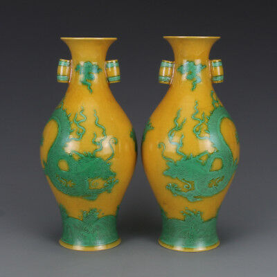 Chinese Old Marked Yellow Green Colored Carved Dragon Porcelain Cross-Ear Vases