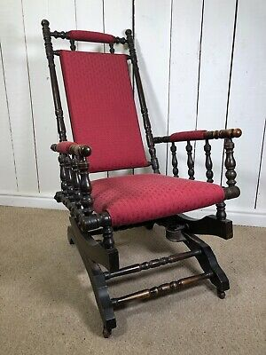Vintage Antique American Rocking Chair With Red Upholstery and Dark Frame