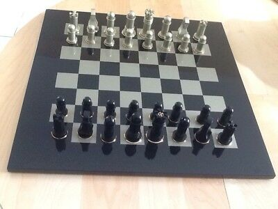 Armani Casa chessboard lacquered and gold plated.