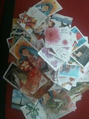 200 x  Unfranked 50 Cent Stamps OFF PAPER !  Face Value $100. FREEPOST.