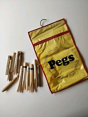 12 Vintage Wooden Pegs And 50s Plastic Peg Bag