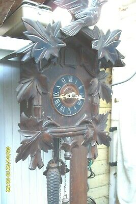 cuckoo clock large clock with weights and pendulum