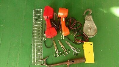Bell System telephone lineman's tool lot. Line hook, snippers, test sets, pulley