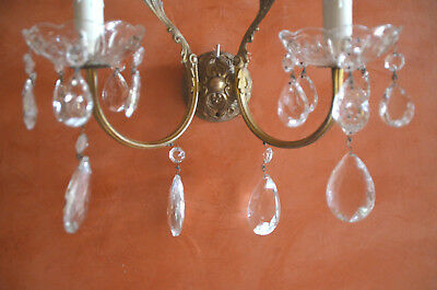 A pair of antique French solid bronze wall sconces, glass prisms
