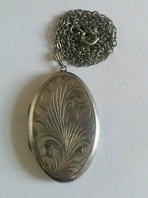 large vintage sterling silver Victorian style locket on silver chain.
