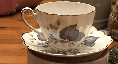 Fine Bone China Cup And Saucer. Blue Leaves, Gold Trim. Made In England