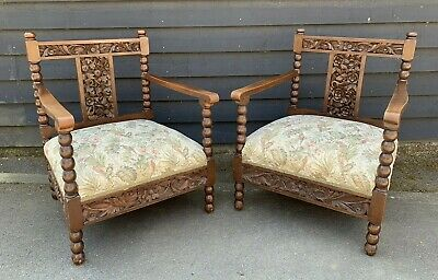 Pair Of Vintage Oak Frame Armchairs With Lovely Detailed Carved Panels