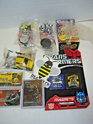 Lot of assorted Transformers elated collectibles magnets, mini figures, cards ++