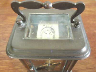 Antique brass 8 day carriage clock .working order with key.