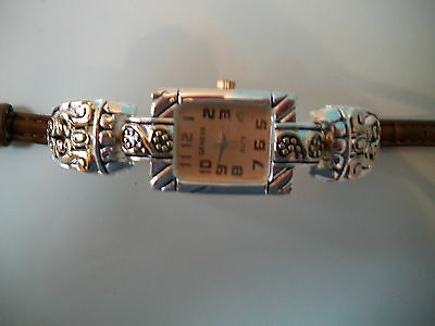 Women's western style silver and gold tone brown leather band fashion watch