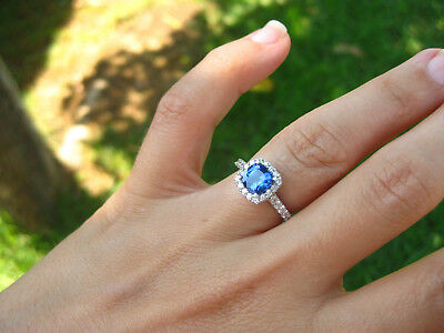 Platinum sapphire and diamond halo engagement ring and diamond wedding band