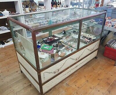 Display cabinet or shop counter with folk art base