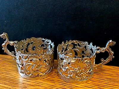 Two antique sterling silver coffee cup holders. Birmingham 1899. Rococo style.