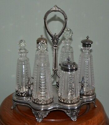 ORNATE VICTORIAN SIX BOTTLE AND EPNS SILVER PLATED CRUET SET c1890