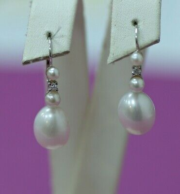 Vintage 14K white gold earrings with pearls & diamonds.