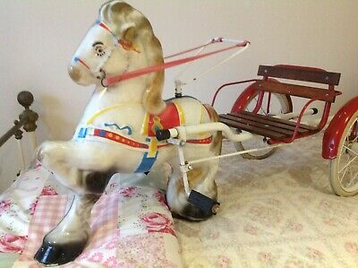 Vintage mobo horse on wheels,tin toy horse and cart,ride along toy horse.