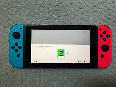 Nintendo Switch 32GB Console with Neon Blue and Red Controllers