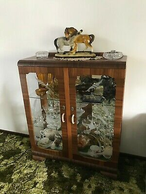 Unique art deco display cabinet with glass etched doors and glass shelving