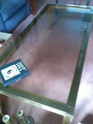 Clear Glass coffee table top with brass legs art deco style