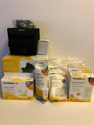 Medela Breast Pump with accessories, please read....
