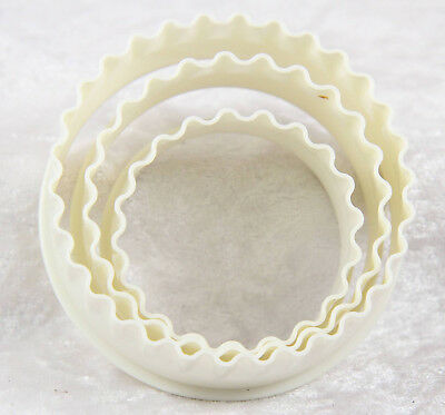 4 x plastic pastry cutters 3 round white one 1 red gingerbread man shaped