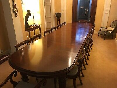 Antique Victorian Mahogany extending dining table, carved legs, castors, chairs.