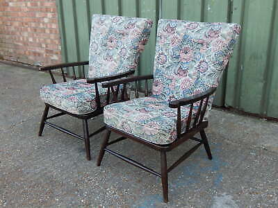 Pair of vintage oak framed floral upholstered armchairs fireside reading chairs