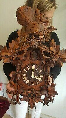Beautifully carved antique cuckoo clock