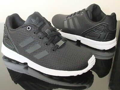 differently 03c9a 8f66d ADIDAS ZX FLUX Boys Shoes Trainers Uk Size 10 - 2.5 Kids Black Bb9105