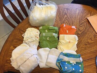Lot of 4 gdiapers with 6 Plastic Liners. 2 other diapers Size Small.Barely Used.