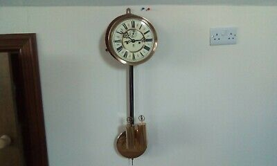 Complete late 19th century gustav becker wall clock movement and dial.