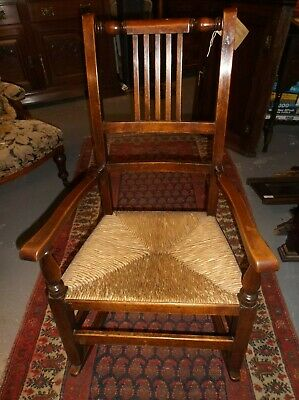 A Lovely Victorian Rush Seated Oak Rocking Chair