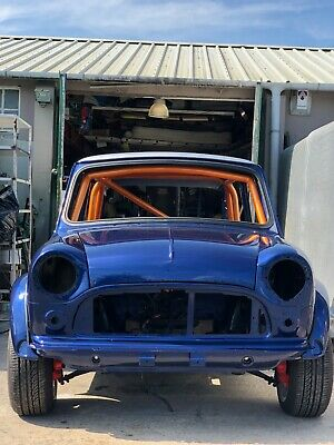 Austin Mini, fully restored with 6 point race cage fitted.