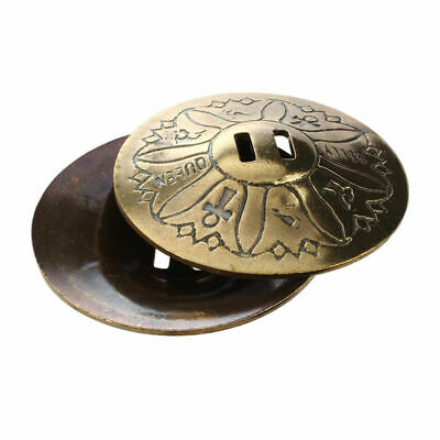 for the belly dance, pair of finger cymbals, in copper, gilded U5F9