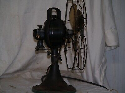General Electric 12 in. four brass bladed antique electric fan.