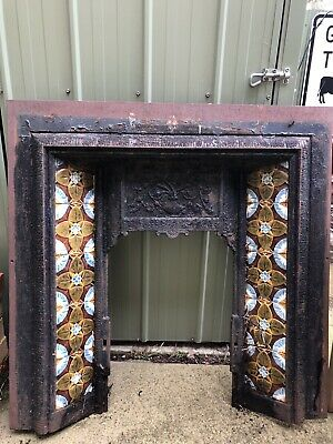 Victorian fireplace cast iron and pressed metal designs. Hand made tiles.