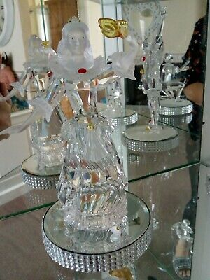 Swarovski columbine, boxed, perfect, comes with mirrored display stand.