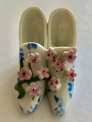 vintage ceramic minature 2 white pointed shoes together with pink flowers