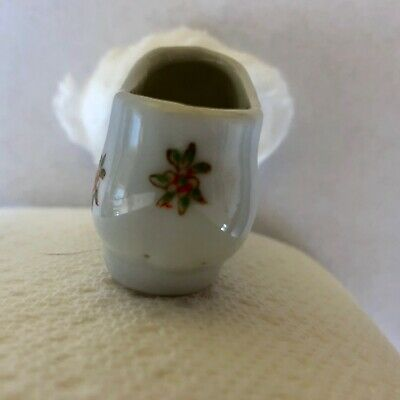 vintage ceramic minature white pointed shoe with 3 dimensional blue flowers