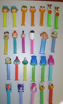 Lot of 24 PEZ DISPENSERS Characters Garfield Odie Flintstones Smurfs Trolls Poni