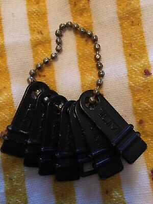 Signature Tumi Luggage Zipper Tags, Lot of 7, Black Logo Metal Keychains or Fobs