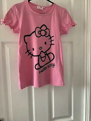 Hello Kitty Girls - Pink T-shirt With Bows On Sleeves. 9-10 Years. Used VGC
